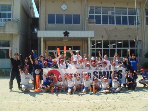 Children Playing with cricket kits donated by Cricket for care - Japan